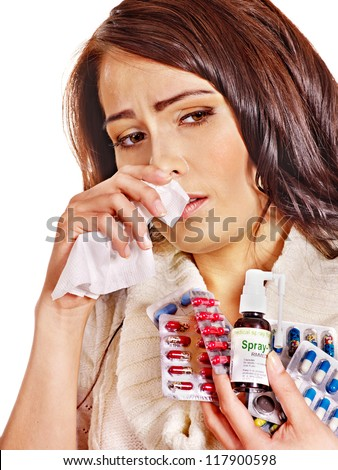 Young woman with handkerchief having  tablets and pills.  Isolated.