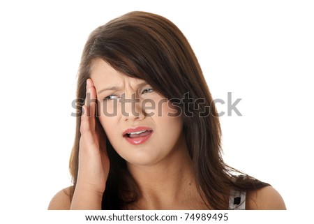 Young woman with headache holding her hand to the head, isolated on white