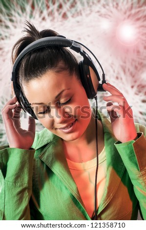 Young  woman with headphone listening to music