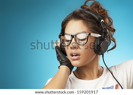Young woman with headphones listening music .Music teenager girl dancing