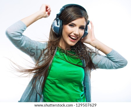 Young woman with headphones listening music .Music teenager girl dancing against isolated white background
