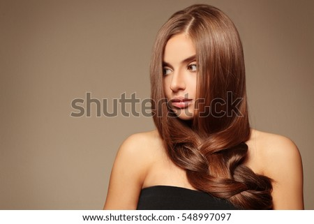 Young woman with healthy hair on color background #548997097