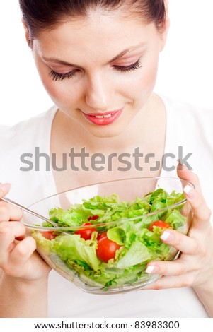 Young woman with healthy salad. Isolated over white.