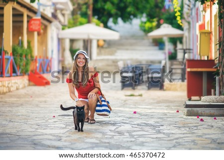 young woman with her cat in...
