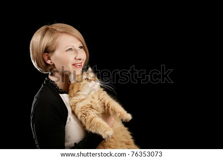 Young woman with her cat isolated on black