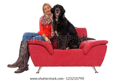 Young woman with her dog on a couch / Woman and Dog