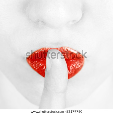 Young woman with her finger on lips
