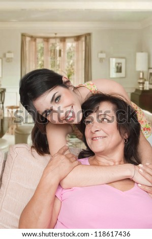 Young woman with her mother at home