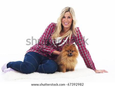 Young woman with her Pomeranian dog