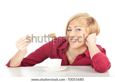 young woman with honey nd white cup