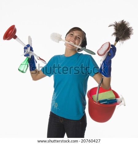 Young woman with house cleaning tools and supplies