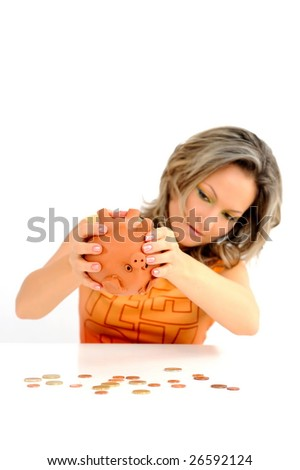 young woman with in piggy bank against white