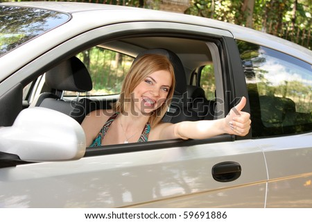 young woman with keys to new car