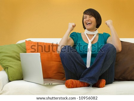 young woman with laptop on a sofa