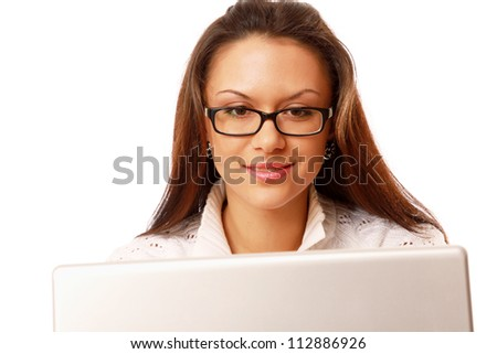 Young woman with laptop smiling at camera isolated on white background