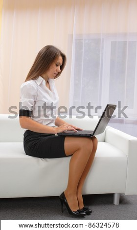young woman with laptop. smiling face
