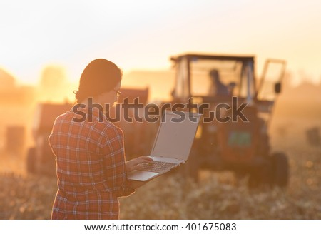 young woman with laptop...