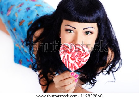 Young woman with lolipop candy