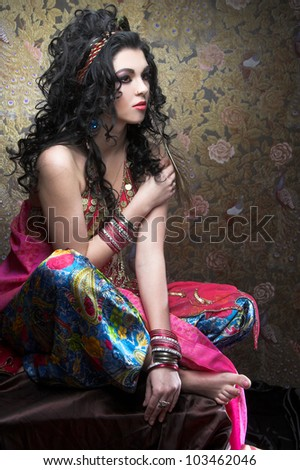Young woman with long dark hair and in east costume