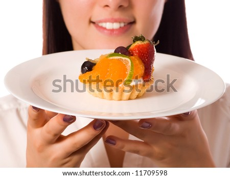 young woman with low-calorie fruit cake (focus on cake)