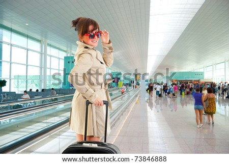 Young woman with luggage at the international airport