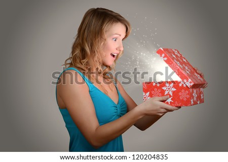 Young woman with magic christmas gift - stock photo