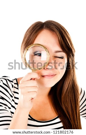 young woman with magnifying glass isolated on a white background