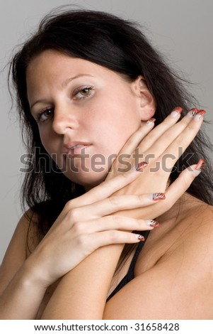 Young woman with manicured hands with nice nails.
