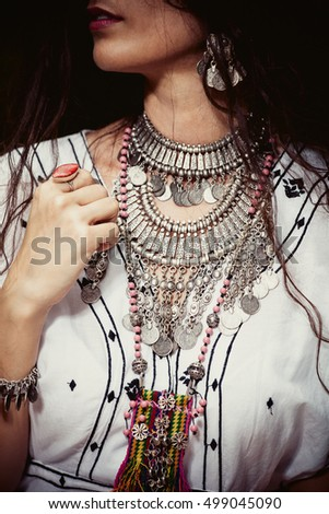 young woman with massive necklace in boho style