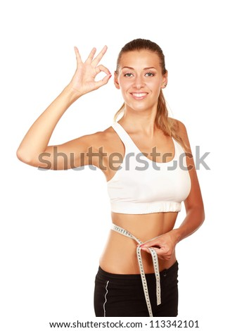 Young woman with measure tape