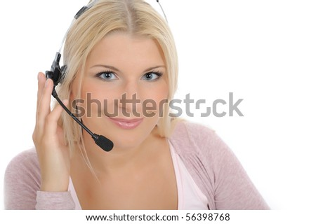 Young woman with microphone and computer having online conversation throw internet. help desk assistant