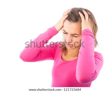 Young woman with migraine holding her hands to the head isolated on white