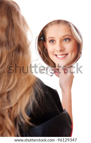 young woman with mirror over white background