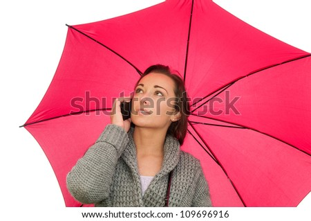 young woman with mobile phone under the umbrella