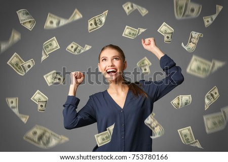 Young woman with money on grey background