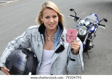 Young woman with motorcycle and French license