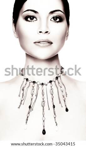 young woman with necklace, studio shot light background