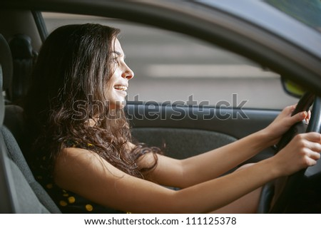 Young woman with nice car on road.