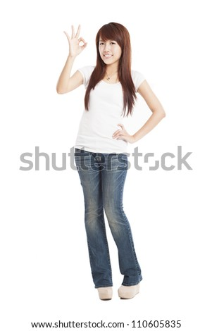 young Woman with ok gesture and standing in full length