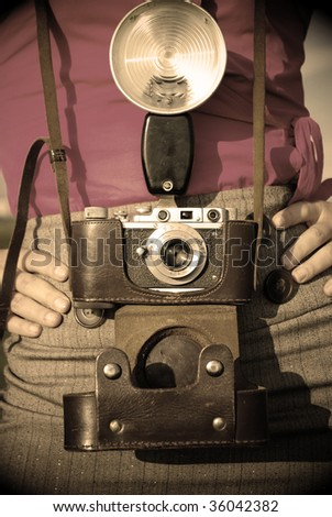 Young woman with old camera outdoor. Retro style. #36042382