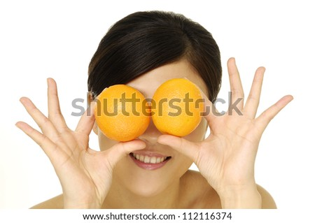 Young woman with orange fruit fun