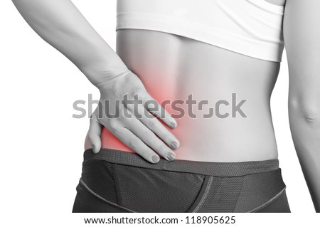 Young woman with pain in her lower back