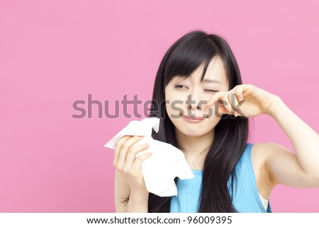 young woman with paper tissue