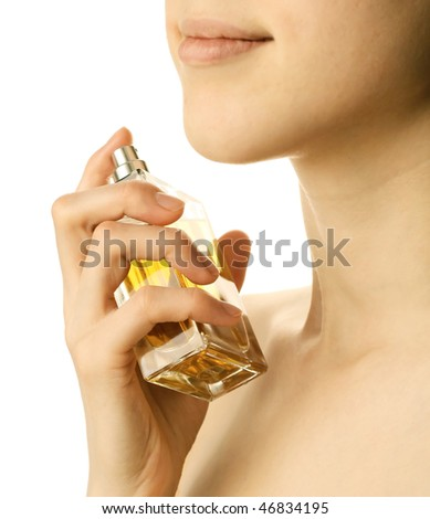 Young woman with perfume bottle