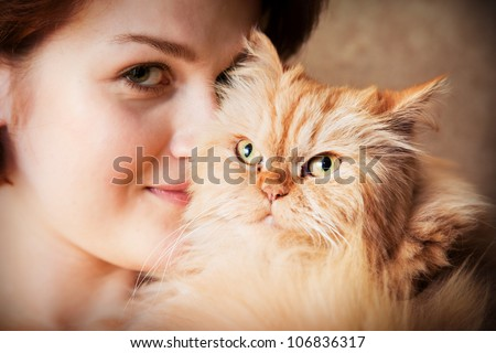Young woman with Persian cat smiling portrait
