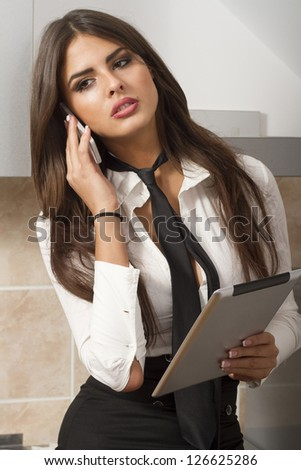 Young woman with phone and tablet pc