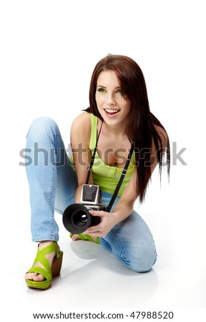 Young woman with photo camera. Isolated over white background