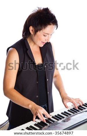 Young woman with piano on white background