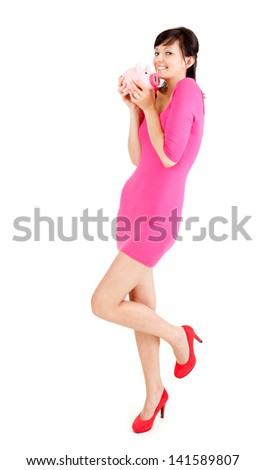 young woman with piggy bank, full lenght, white background