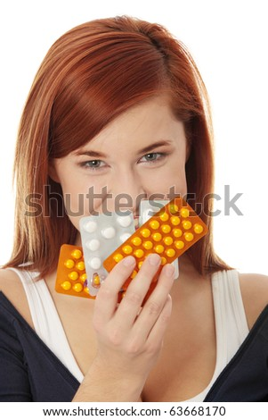 Young woman with pills isolated